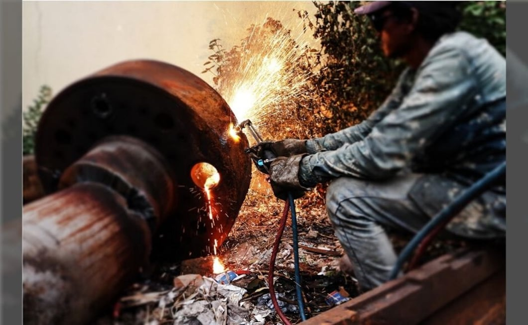 A worker welding the scrap in a local foundry at Ichalkaranji town of Maharashtra.