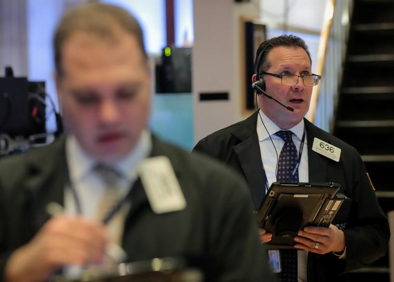 Wall St edges higher as upbeat earnings dampened by trade, shutdown woes
