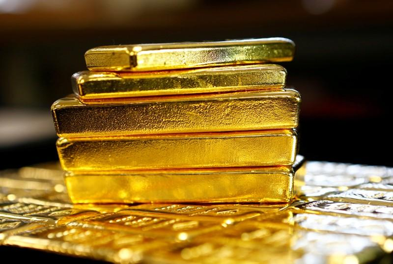 Gold soars to over seven-month high as dollar falls ahead of Fed meet