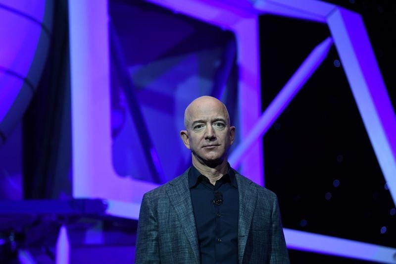 Bezos Blue Origin aims to fly first space passengers by April  CNBC