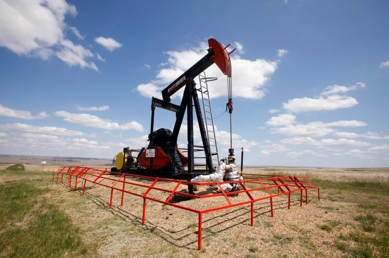 Oil prices dip as US crude output hits record 12 million barrels per day