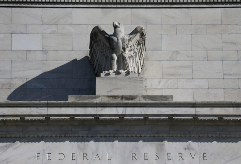 Fed sees no rate hikes in 2019 plans to slow balance sheet reduction