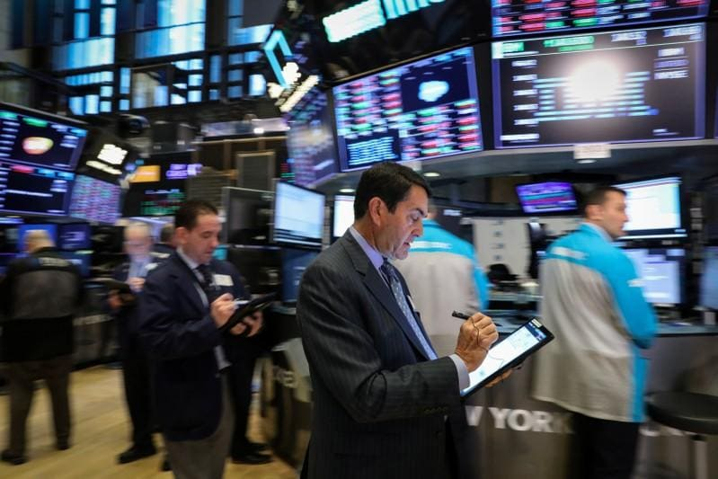 World shares dip in wobbly session; pound slides, oil jumps