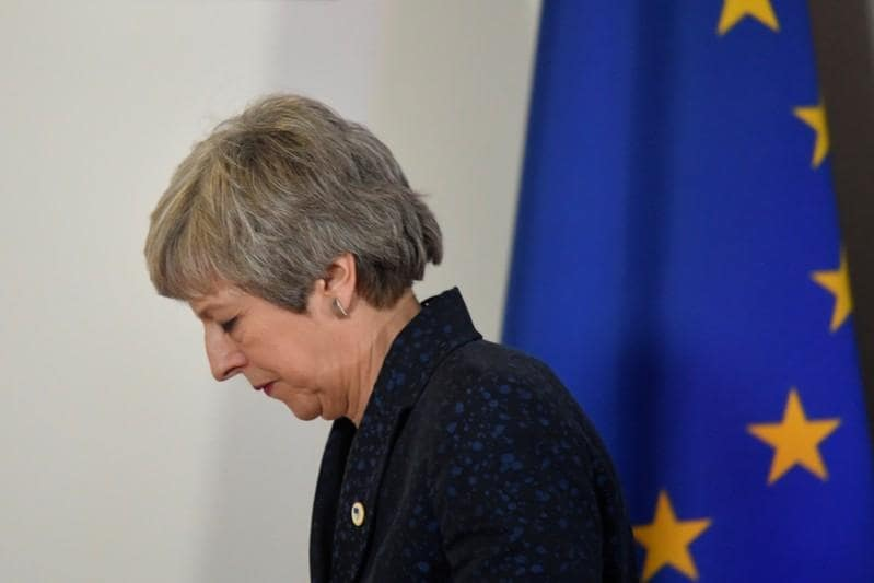 May in fight to retain grip on Brexit as parliament seeks control