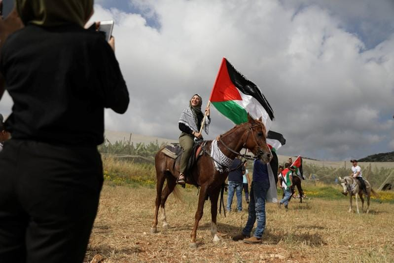 Mourning Arabs fly Palestinian flags as Israel marks Independence Day