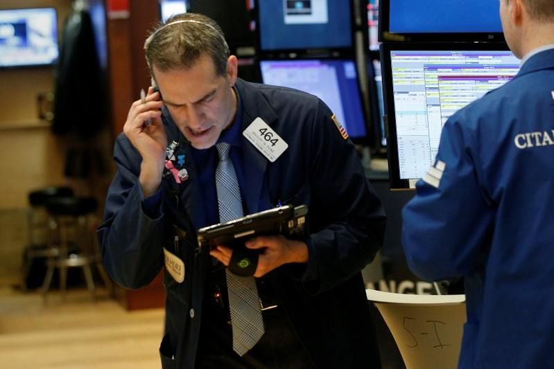 Wall St gains on strong earnings, tech resurgence