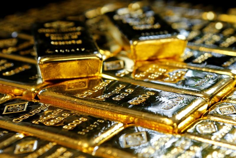Gold near three-week lows as dollar, equities rise