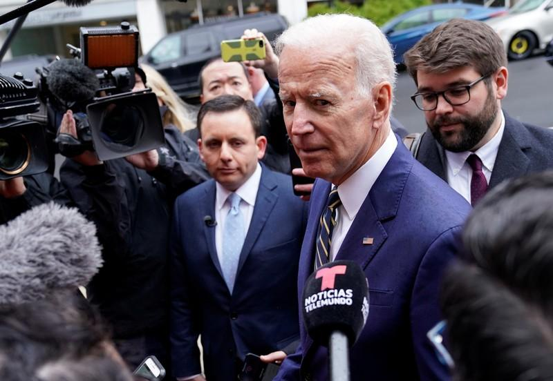 Amid complaints about unwanted touching, Biden jokes he got permission to hug