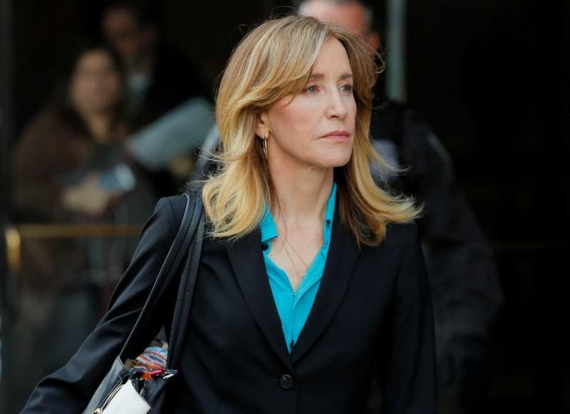 U.S. slaps more charges on parents in college admissions cheating scandal