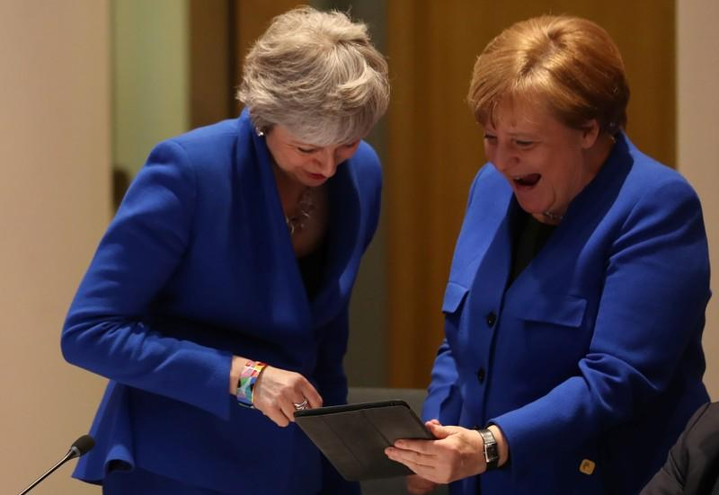 Snap! Jolly Merkel breaks Brexit summit ice with May
