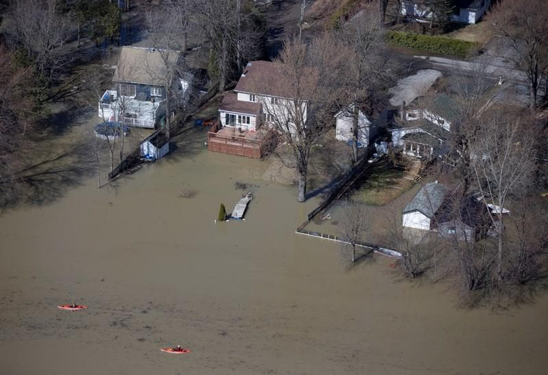 Spring floods in Canadas Quebec leave one dead, force evacuations