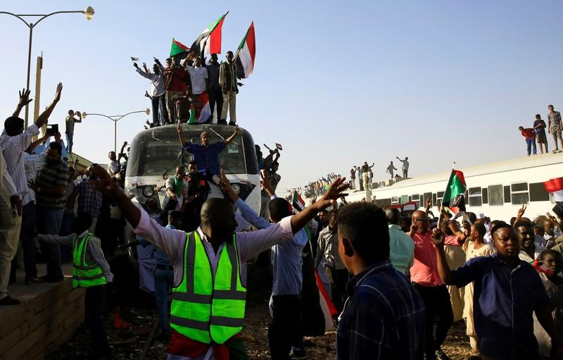 Three members of Sudan military council resign after demand by opposition