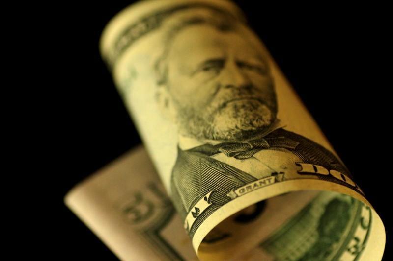 Dollar, yields slide on soft U.S. inflation, stocks rally