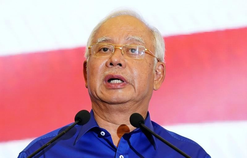 Malaysia's Najib says to take short break, follows reports he may leave for Jakarta