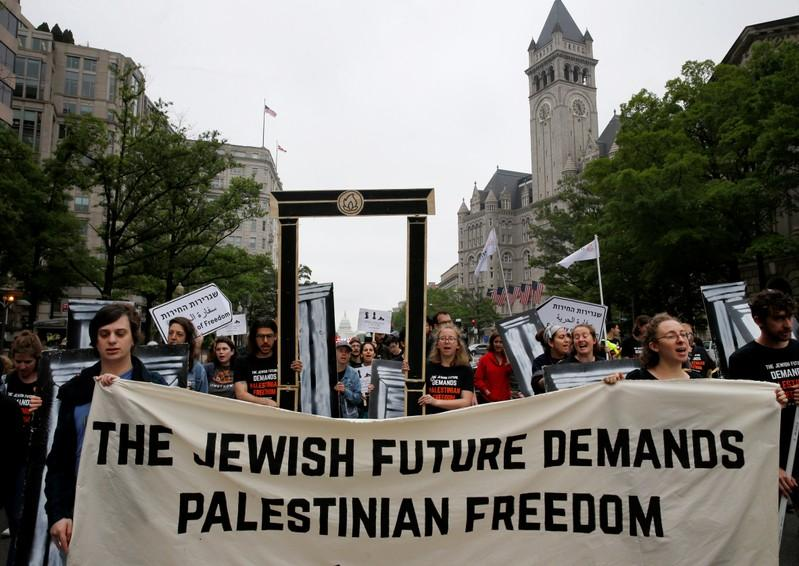 Singing Washington protesters denounce U.S.' Israel embassy move