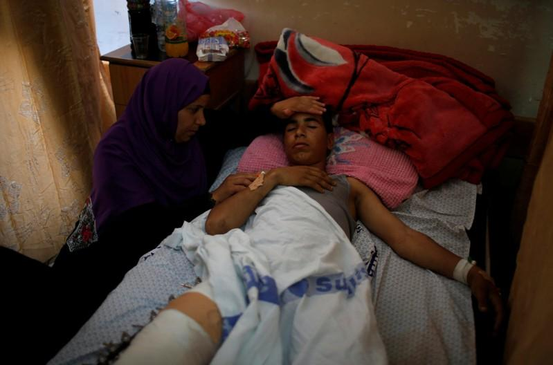 Gaza hospitals strive to cope with numbers of wounded protesters