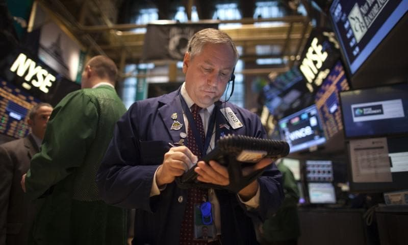 Wall St. ends down slightly on trade, oil price concerns