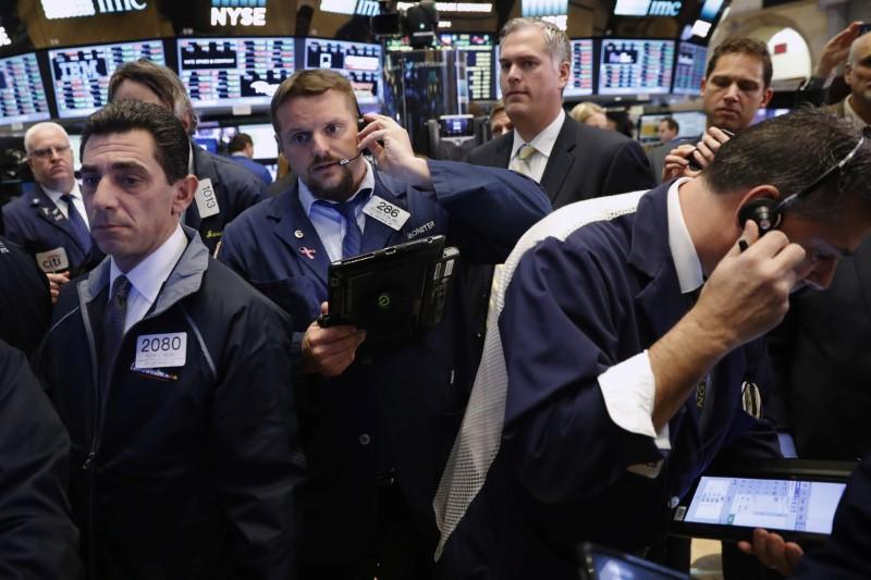 S&P, Dow lower on oil plunge; chipmakers lift Nasdaq