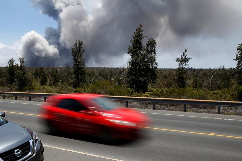 Hawaii street swallowed by 'lava tide' as more homes burn