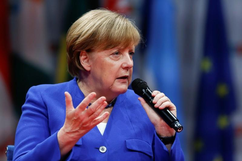 Merkel says political hate speech is playing with fire