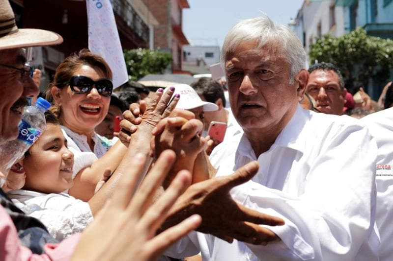 As Mexico vote looms, leftists support jumps to 52 percent - poll