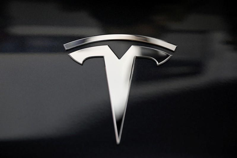 Tesla says it plans software update amid vehicle fire investigation