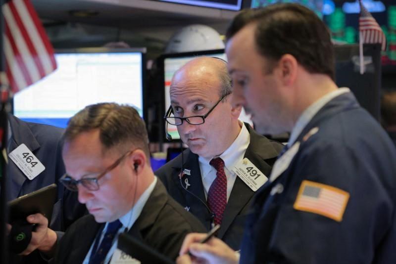 World shares rocky, yuan weakens as global trade talk shakes markets