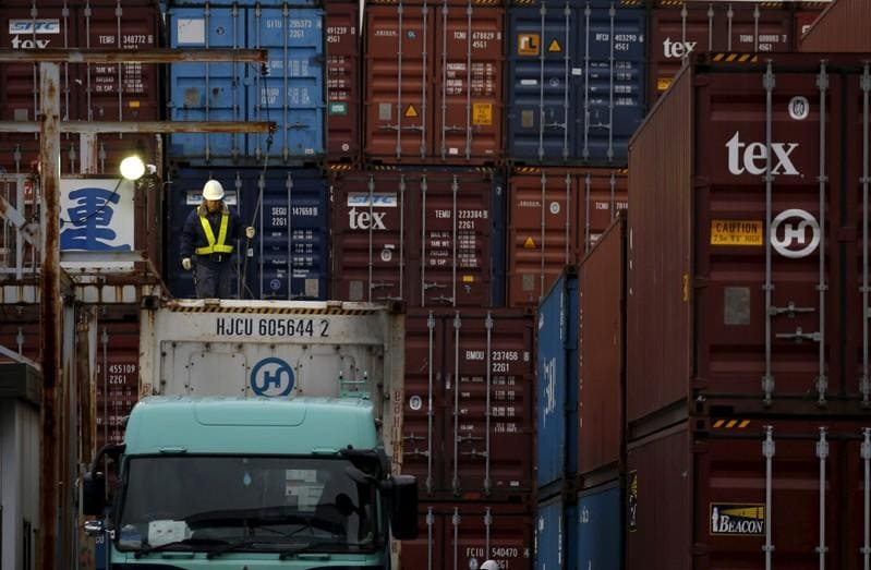 Japan exports fall again but business sentiment offers hope