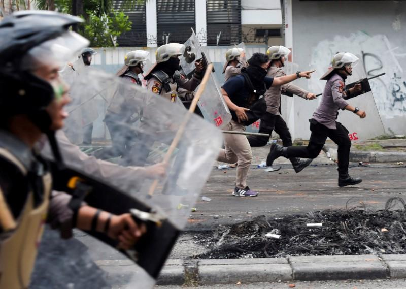 Indonesian protesters, police clash in second night of post-election unrest