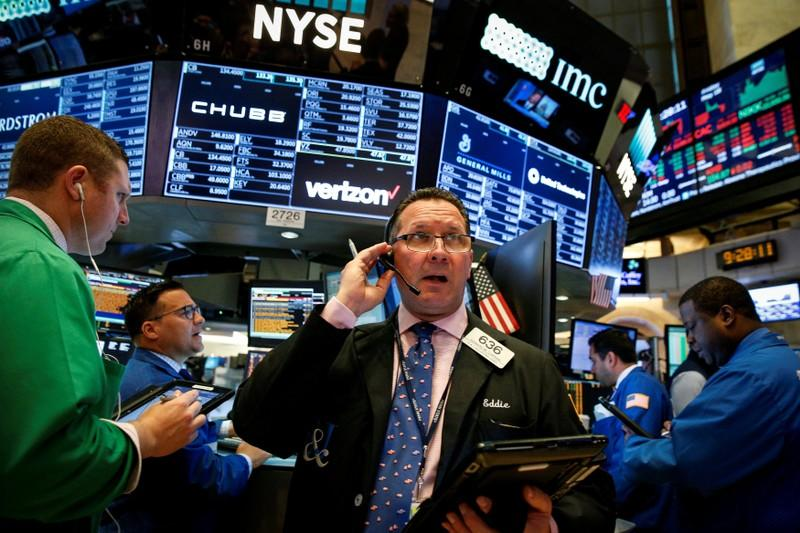 Wall Street rises, investors eye Fed decision, summit fears ebb