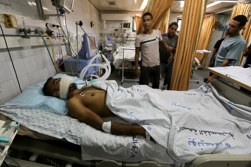 Wider Image: Tear-gas canister puts Gazan on life support