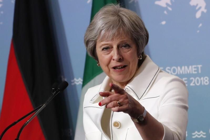 Britain's May urges Conservative unity before parliament votes