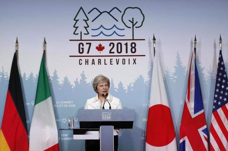 After 'difficult' G7 summit, UK's May warns against unilateral action on trade