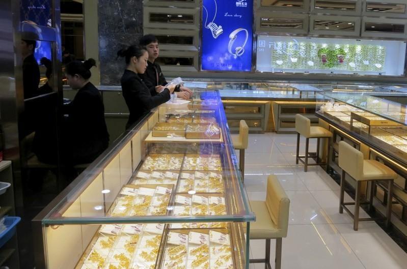 Gold eases on firmer dollar; U.S.-N.Korea summit, Fed meeting in focus