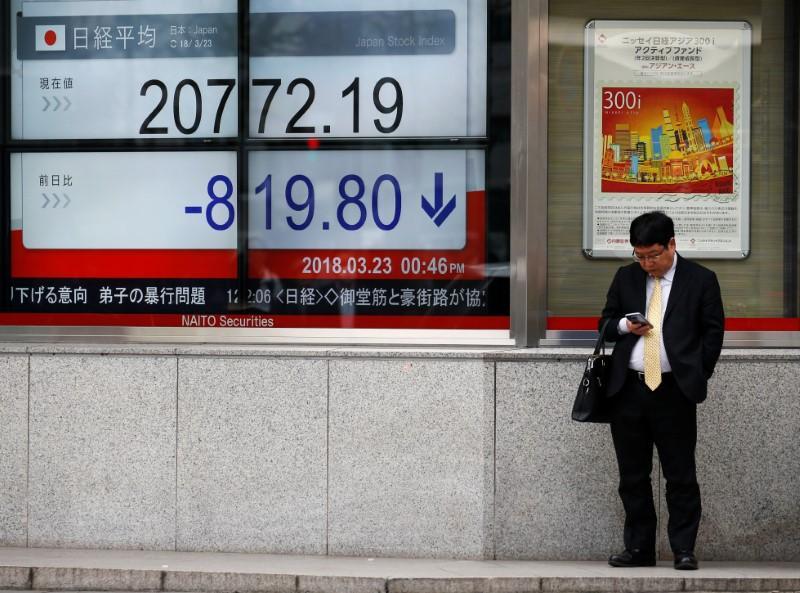 Asian shares down on Fed hike, Sino-U.S. trade anxiety