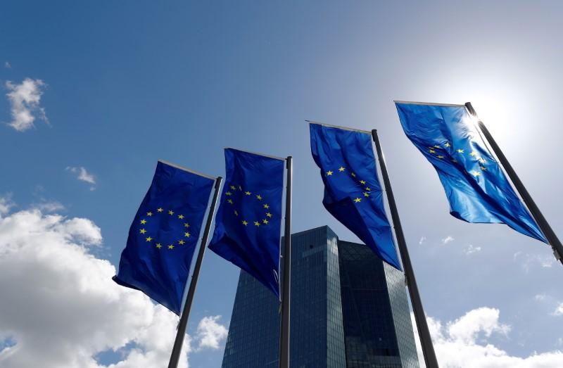 ECB to end bond buying but pushes out first rate hike