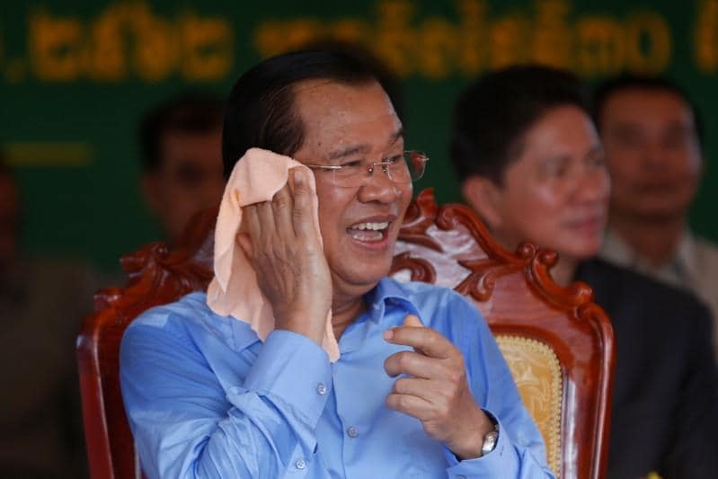 Crackdown and cash: Hun Sens recipe for victory in Cambodian poll