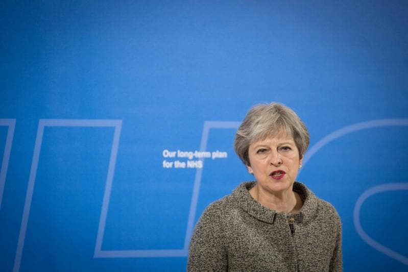 PM May dismisses report she questioned UK status as 'tier one' military power