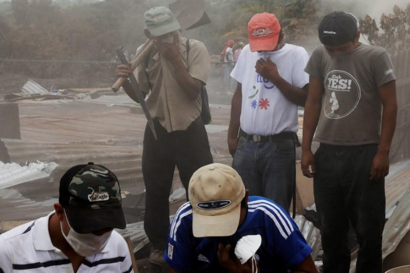 Lone woman digs for family lost under Guatemalan volcanic rubble