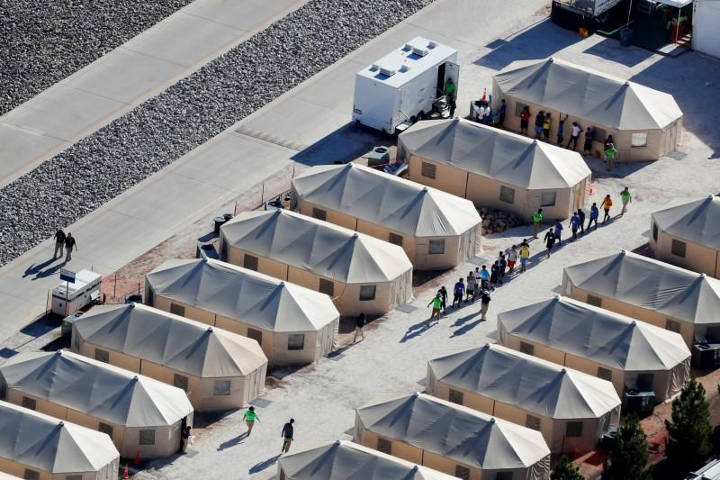 U.S. says still working to reunite 2,053 children with families