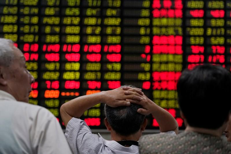 Global stocks recover slightly from trade fight damage