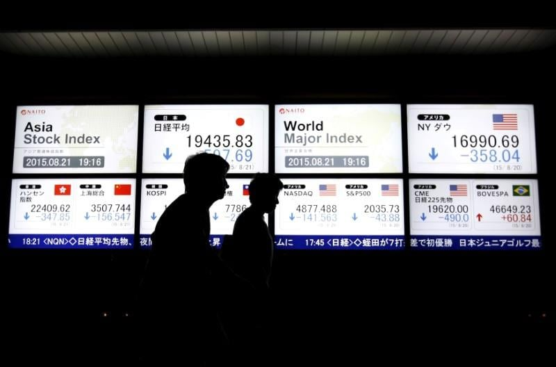 Asian shares flirt with 9-month low on mounting trade war fears