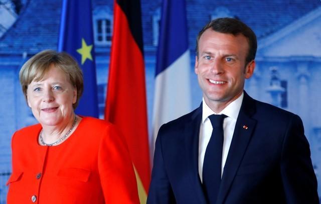 Italy sets high demands on EU migration deal Merkel needs