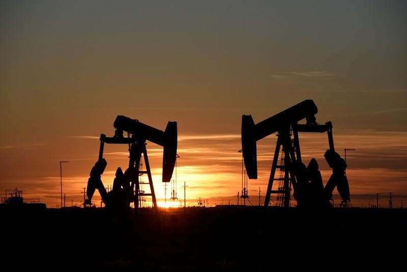 Oil bounces off 4-month low, turns positive as stocks rally