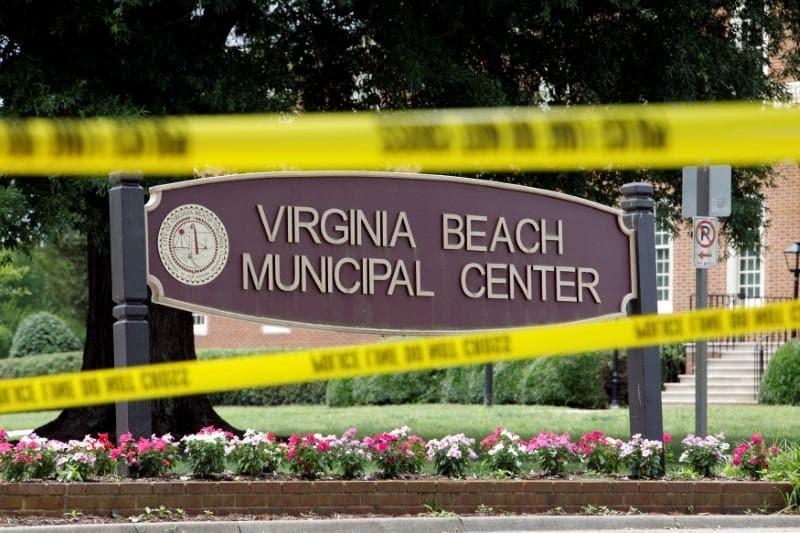 After massacre, Virginia governor takes on Republican legislature over gun control
