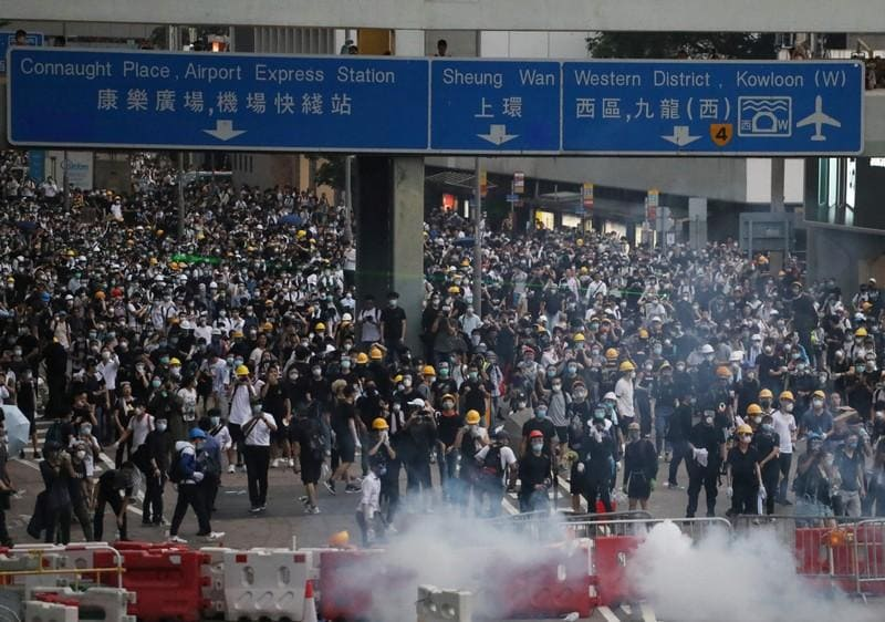 Uneasy calm in Hong Kong after day of violence over extradition bill