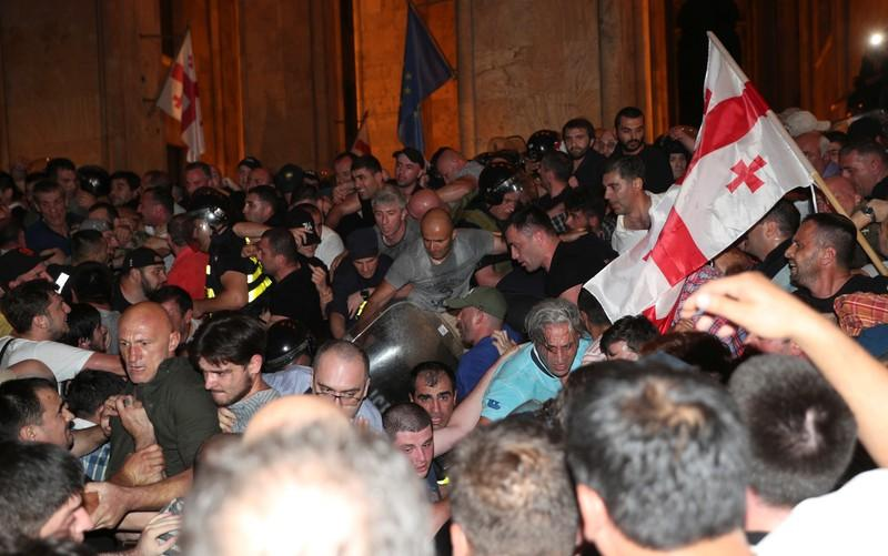 Georgians angry over Russian lawmakers visit try to storm parliament