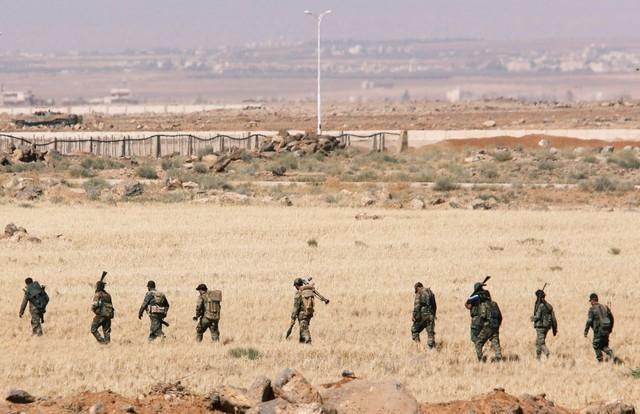 Syrian troops celebrate seizing Jordan border crossing