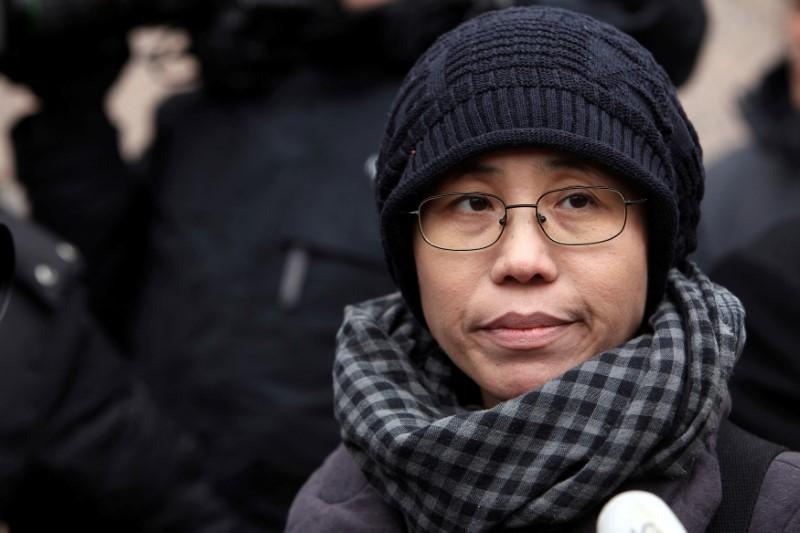 Liu Xia: Nobel laureate's widow allowed to leave China for Europe
