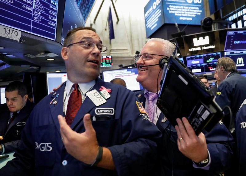 Stocks, commodities regain footing after dropping on trade worries